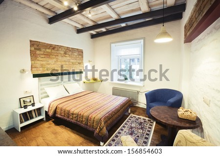 Bedroom - the interior of a cozy studio-type guest house - stock photo