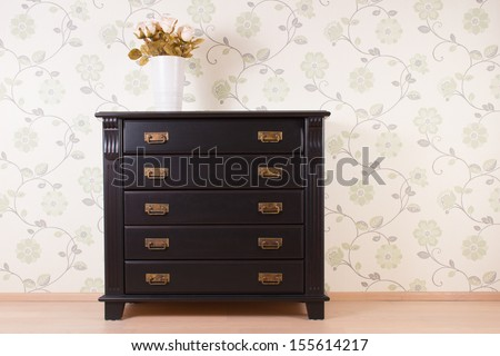 Bedroom wall with classic furniture and roses - stock photo