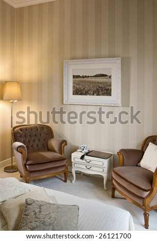 bedroom with armchairs - stock photo
