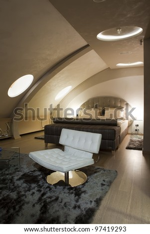 Bedroom with curved ceiling - stock photo