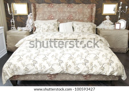 bedroom with large bed - stock photo
