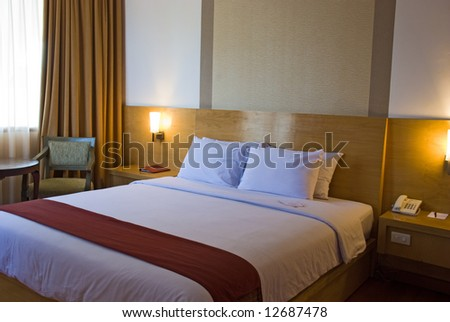 Bedroom with light on at night - stock photo