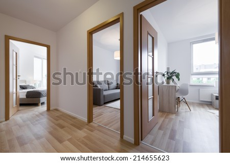 Bedrooms in modern apartment - view from corridor - stock photo