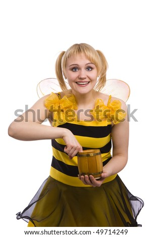 Bee costumes woman is eating honey. Woman wearing fancy dress on Halloween looking surprised. Cute girl in bee costume on white. - stock photo