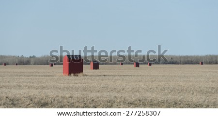 Bee huts in a field, Manitoba, Canada - stock photo