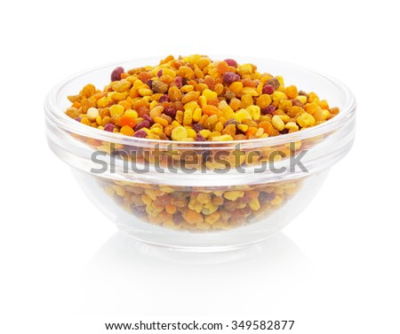 Bee pollen in the bowl closeup isolated on white background - stock photo