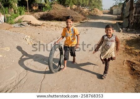 BEED, MAHARASHTRA, INDIA - March 23, 2012: unidentified girls playing in rural village Salunkwadi - stock photo