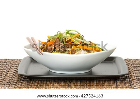 Beef and cabbage stirfry on white rice - stock photo