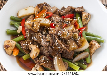 Beef and green bean stir fried dinner on rice.  - stock photo