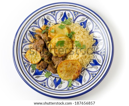 Beef and sweet potato tagine served with couscous and a coriander garnish on a handmade north-African plate, a traditional Moroccan dish from Fez - stock photo