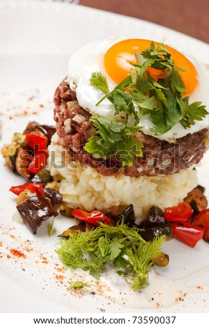 beef burger with egg and potatoes - stock photo