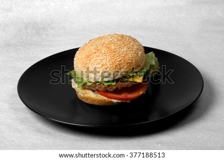 beef burger with grilled bacon cheese and sliced tomato  - American food - fast food - junk food - stock photo