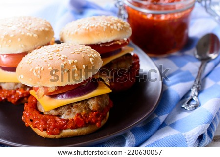 Beef burgers stuffed with vegetables and ajvar salad,selective focus  - stock photo