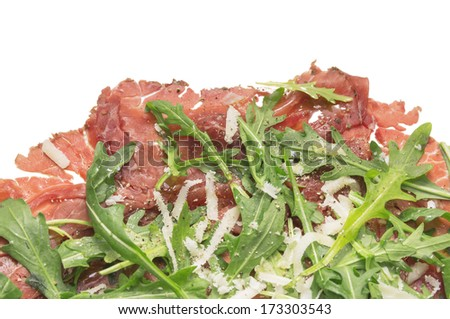 Beef Carpaccio with rucola and Parmesan cheese , isolated - stock photo