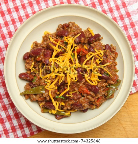Beef chili with grated cheese. - stock photo