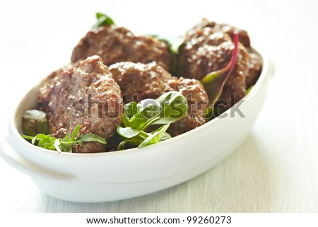 Beef cutlets with a salad - stock photo