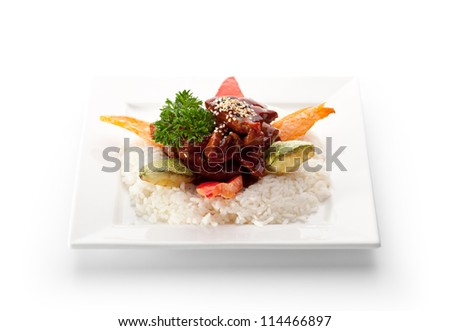 Beef Fried in Sour-Sweet Sauce. Garnished on Sliced Vegetable and Rice - stock photo