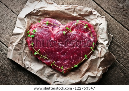 beef heart in paper closeup - stock photo