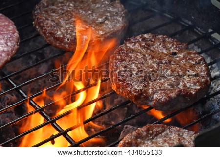 Beef or pork meat barbecue burgers for hamburger prepared grilled on bbq fire flame grill - stock photo