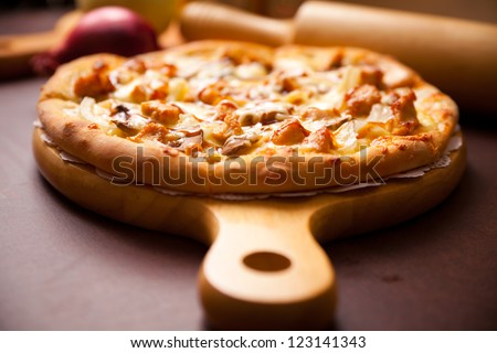 Beef pizza, put on the chopping board - stock photo