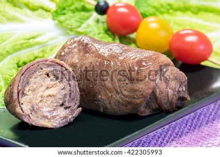 Beef roll, minced meat wrapped in slice of beef - stock photo