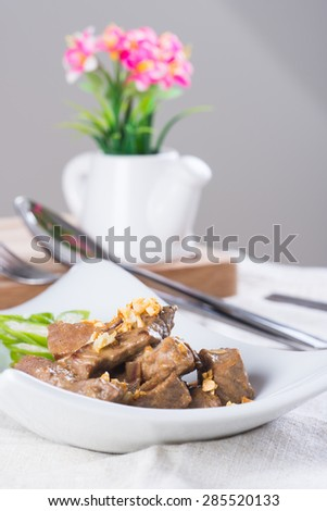 beef salpicao, or beef with creamy soy sauce topped with toasted garlic - stock photo