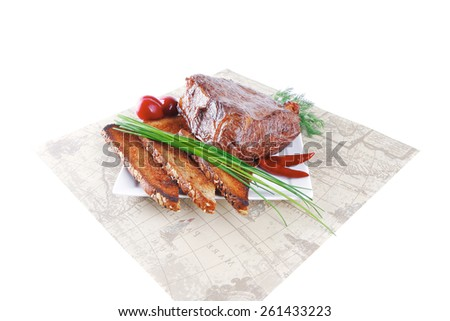 beef served with vegetables on white plate with placement - stock photo