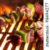 beef shish kababs on the grill - stock photo
