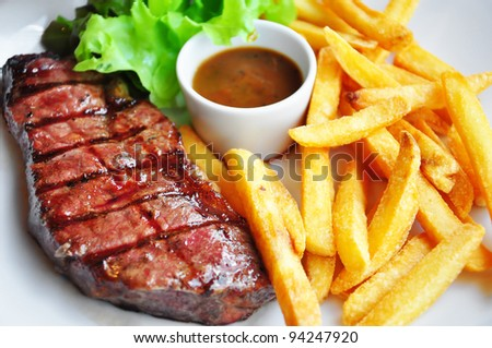 Beef steak and chips - stock photo