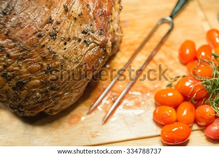 Beef steak medium grilled decorated with tomatoes and green leafs. - stock photo