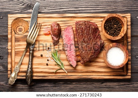 Beef steak medium with salt and pepper - stock photo