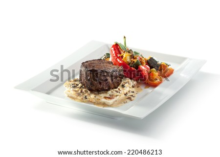 Beef Steak with Mushrooms Sauce and Roasted Vegetables - stock photo