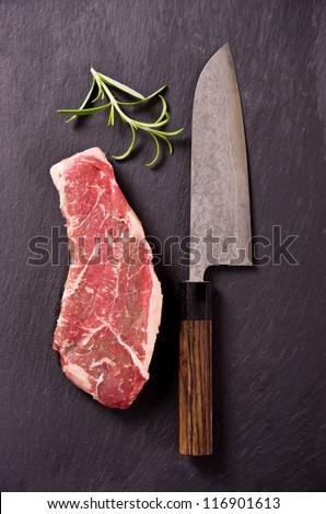 beef steak with santoku knife - stock photo
