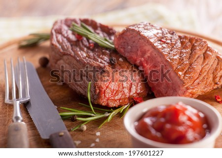 Beef steak with spices  - stock photo