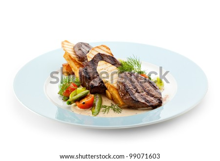 Beef Steak with Vegetables and Potatoes Chips - stock photo