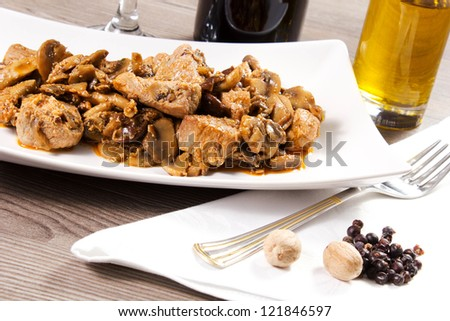 beef stew with mushrooms on the table - stock photo