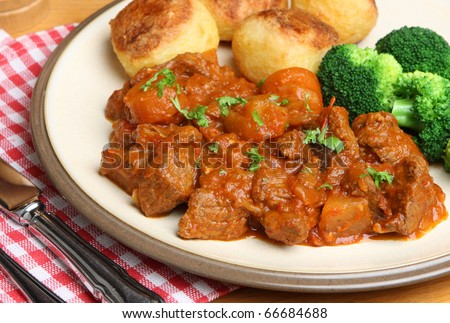 Beef stew with roast potatoes and broccoli - stock photo