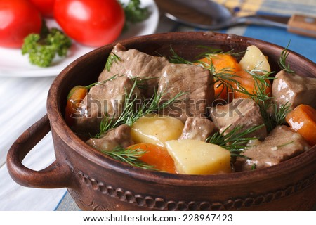 beef stew with vegetables in a pot close up. horizontal.  - stock photo