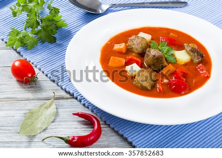 Beef stew with vegetables or goulash, traditional hungarian meal - stock photo