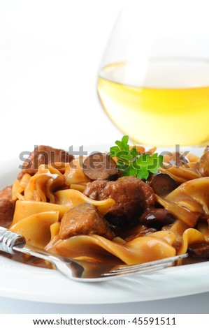 Beef stroganoff, noodles, mushrooms and rich gravy. - stock photo