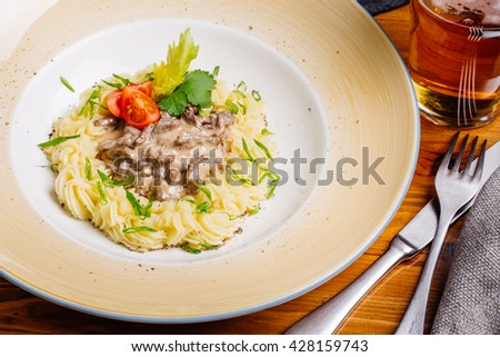 Beef Stroganoff with mashed potatoes. traditional Russian cuisine - stock photo