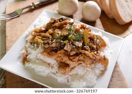 Beef stroganoff with rice - stock photo
