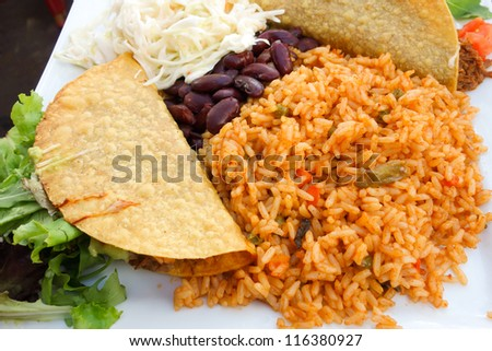 beef tacos served with lettuce and fresh tomatoes - stock photo