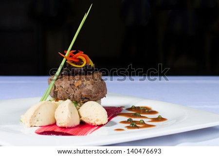 beef tenderloin steak with mashed potatoes, pepper sauce and beetroot sauce - stock photo