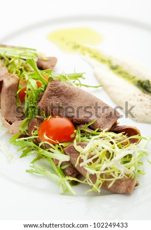 Beef Tongue Salad with Fresh Greens and Horseradish Sauce - stock photo