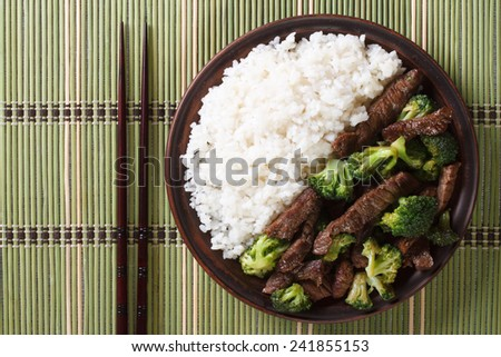 beef with broccoli and rice on a plate close-up. horizontal view from above  - stock photo