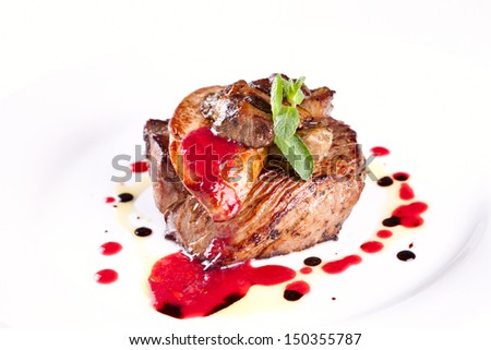 Beefsteak with foie gras and mushrooms - stock photo