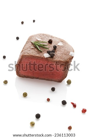 Beefsteak with rosemary and colorful peppercorn isolated on white background. Culinary red meat eating. - stock photo