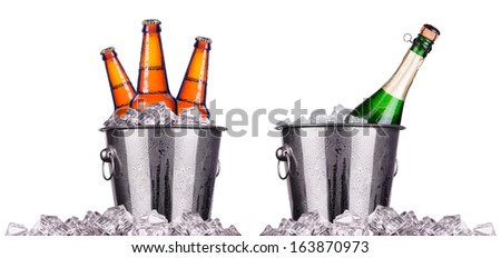 Beer and champagne bottles in ice bucket isolated on white - stock photo