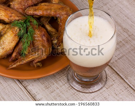 Beer and chicken wings - stock photo